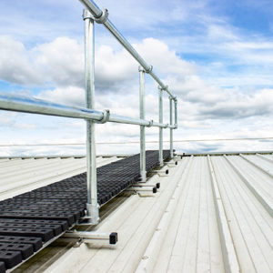 Kee Walk rooftop walkway with guardrail protects workers from fall hazards